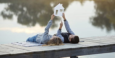 Happy couple of kids dream of a home. House concept